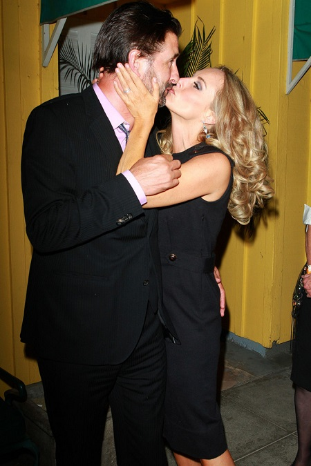 "Chynna Phillips smooches with husband William Baldwin at Dan Tana's restaurant in Los Angeles after the ""Dancing With The Stars"" season premiere."