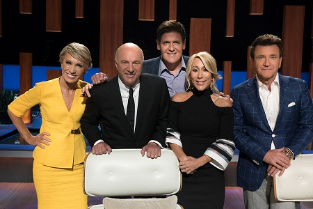 The five 'Shark Tank' investors posing for a photo.