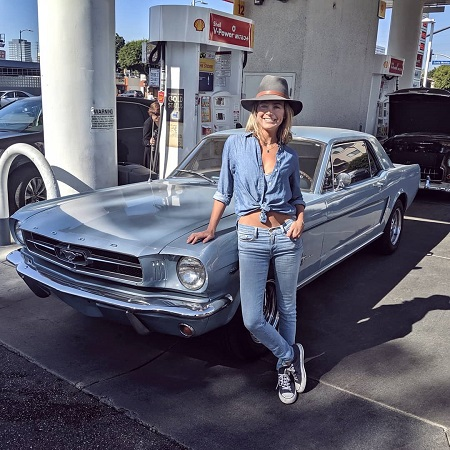 Heather Storm in front of her Mustang.