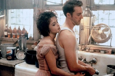 Helena Bonham Carter's Marla Singer hugging Edward Norton's character from behind in 'Fight Club' movie.