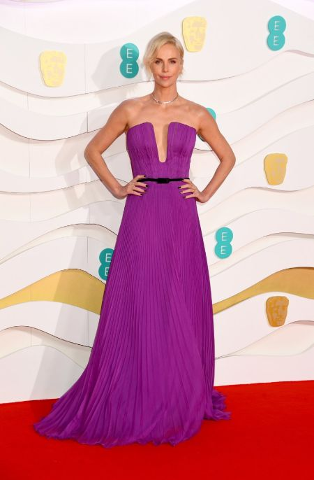 charlize theron in a plunging purple dress