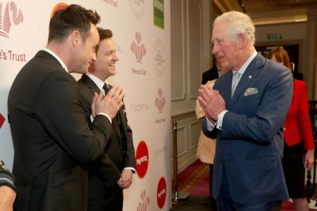 prince charles greeting people with a namastey