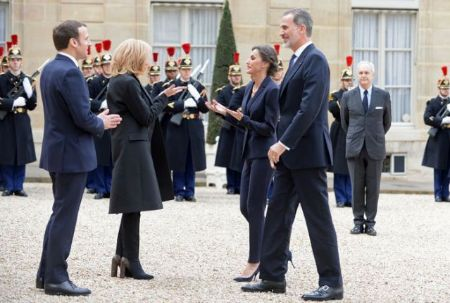 French President Emmanuel Macron greeted Spain's king and queen with Namaste.