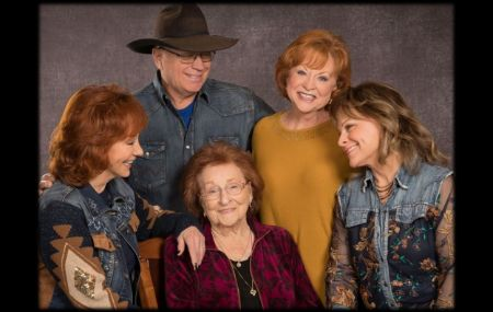 Reba with her family and mother