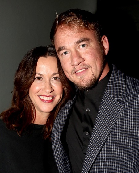 "Alanis Morissette and husband Mario ""Souleye"" Treadway pose at the opening night of the new Alanis Morissette musical ""Jagged Little Pill"" on Broadway at The Broadhurst Theatre on December 5, 2019 in New York City."