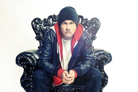 Souleye in a chair in a hiphop attire.