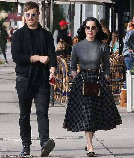 Adam Rajcevich in black dress with girlfriend Dita Von Teese.