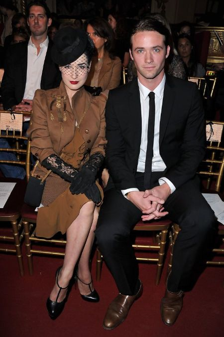 Louis-Mare De Castelbajac and model Dita Von Teese in a formal event pose for a picture.