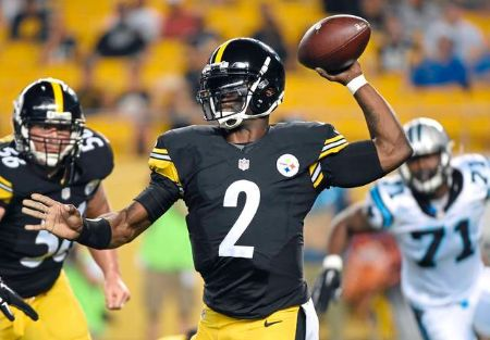 Michael Vick in a football jersey throwing a ball.