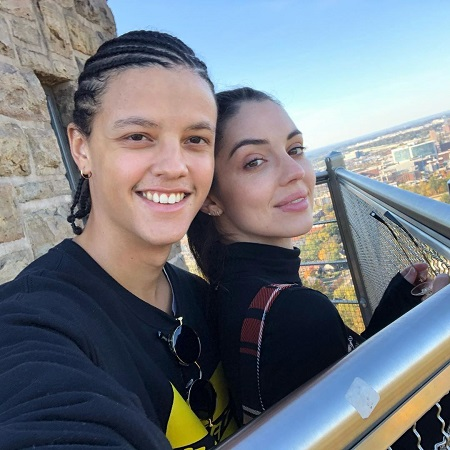 Adelaide Kane with her current boyfriend Jacques Colimon on a tower, taking a selfie.