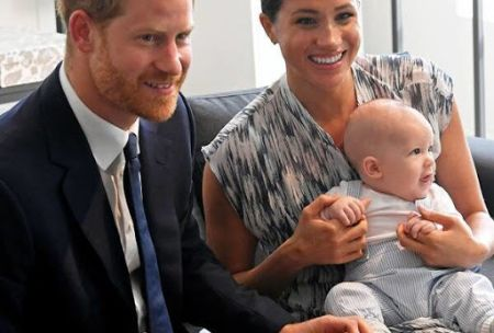 Prince Harry with his wife Meghan Markle and their son