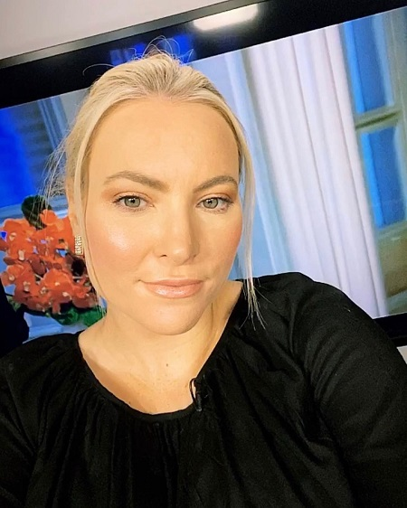 Meghan McCain taking a selfie in her home during a show.