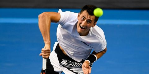 Bernard Tomic while returning a service.