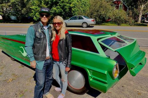 Chad Hiltz and his wife Jolene MacIntyre pose infront of a custom car.