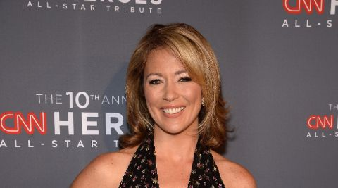 Brooke Baldwin poses a picture in a black dress.