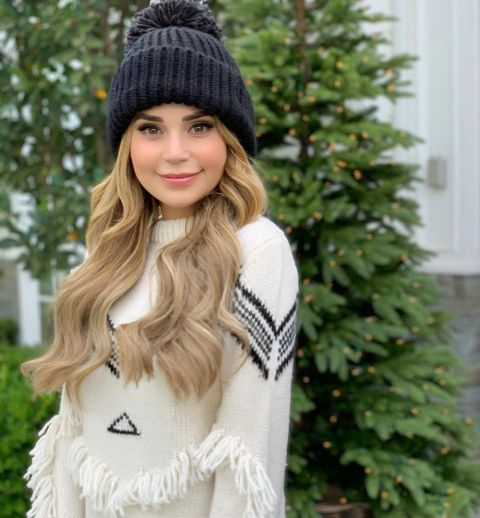 Rosanna Pansino poses a picture wearing a white sweater.