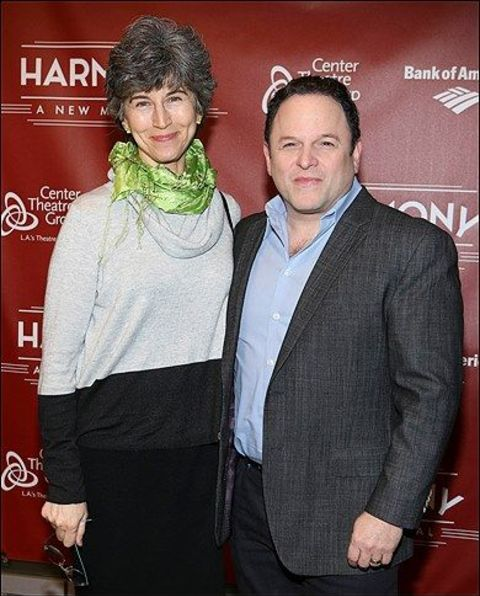 Jason Alexander poses for a picture with his wife.