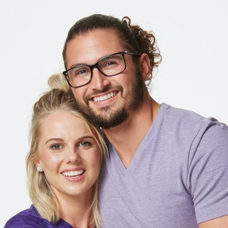 Nicole Franzel and Victor Arroyo pose for a picture.