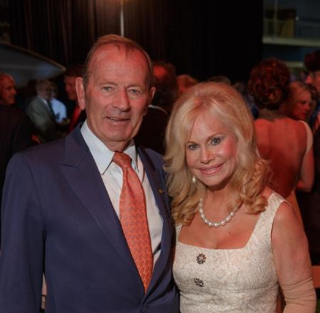 Annabel Bowlen and Pat Bowlen pose for a picture.