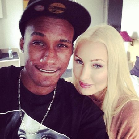 Hopsin and his ex-girlfriend Alyce Madden pose a picture.