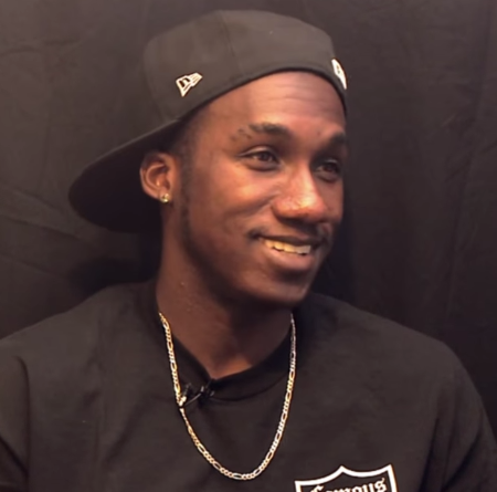 Hopsin in a black t-shirt caught on the camera.