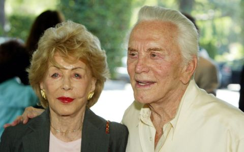 Anne Douglas and Kirk Douglas pose for a picture.