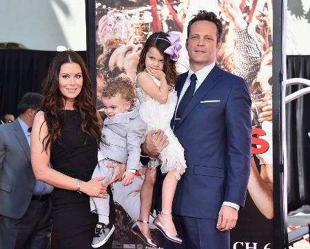 Kyla Weber and her husband Vince Vaughn pose for a picture.