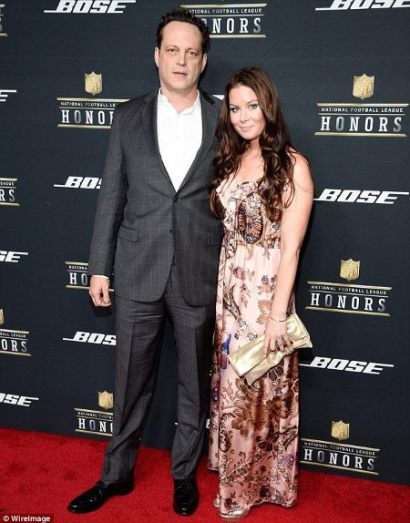 Kyla Weber and her husband Vince Vaughn pose a picture at an event.