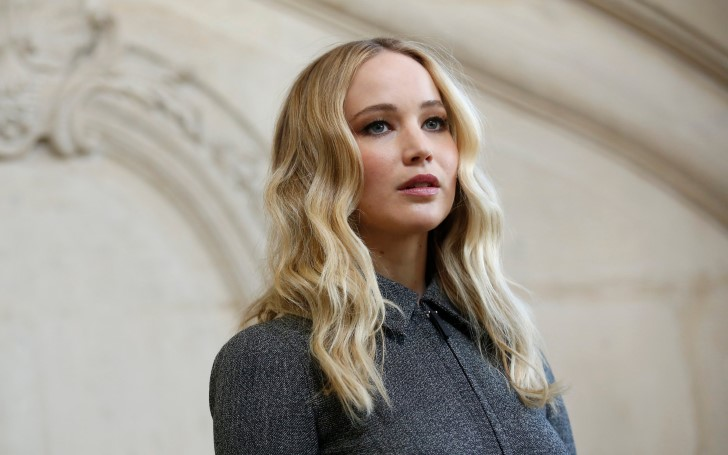 Jennifer Lawrence Displays Her New Engagement Ring at Dior Fashion Show
