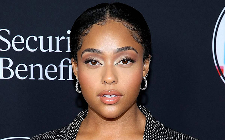 Jordyn Woods Went Braless In Plunging Khaki Dress