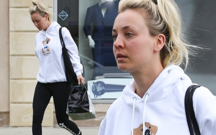Kaley Cuoco Steps Out In Hoodie And Leggings With Long Blonde Hair Up In A Top Knot