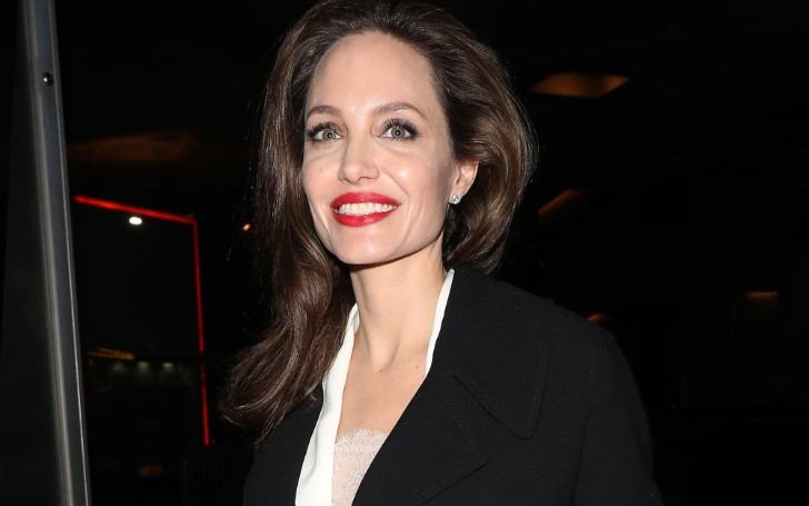 Angelina Jolie Cemented A Classic Winter Combo Long Coat and Long Dress