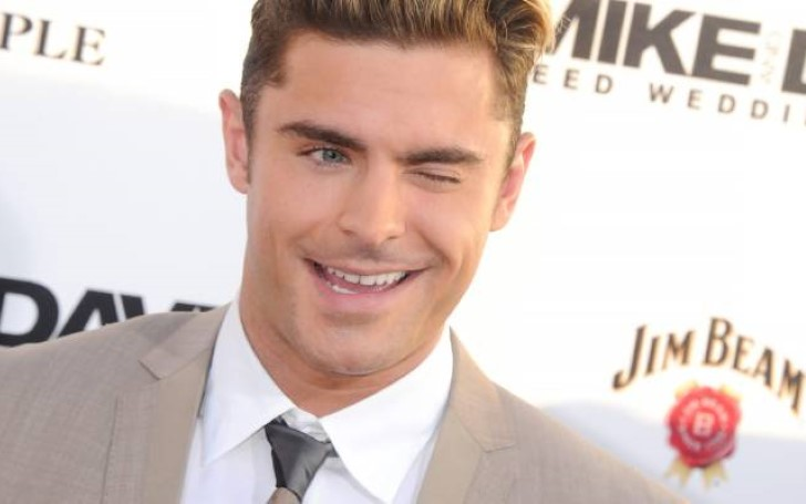 Zac Efron's New And Wild Beach Bum Facial Hair Was Genuinely Inspired By A Panini