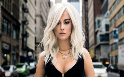 Bebe Rexha Reveals The Secret To Her Bleach Blond Hair And How She Keeps It From Falling Out