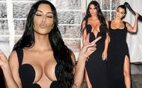 Kim and Kourtney Kardashian Display Extreme Cleavage in Glamourous Black Gowns As They Lead a Glittering Line-Up of Stars At amfAR Gala in New York