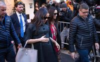 Meghan Markle Cradles Black Overcoat And A Trendy Cap To New York City Ahead of a Baby Shower