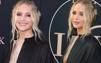 Jennifer Lawrence Displays Cleavage In A Deeply Plunging Black Gown